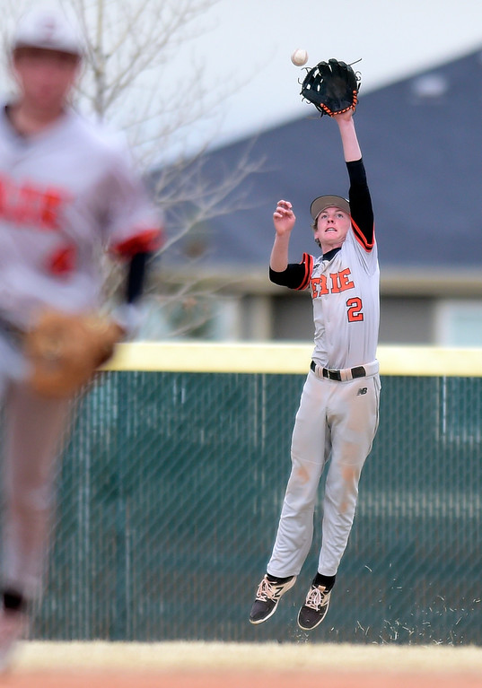 . Erie High School\'s Nash Phillips misses a bad hop during a game against Holy Family on Thursday in Broomfield. More photos: BoCoPreps.com Jeremy Papasso/ Staff Photographer 03/15/2018