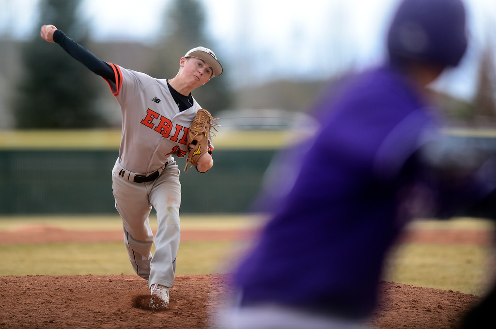 . Erie High School\'s Trevor Ball throws a pitch during a game against Holy Family on Thursday in Broomfield. More photos: BoCoPreps.com Jeremy Papasso/ Staff Photographer 03/15/2018