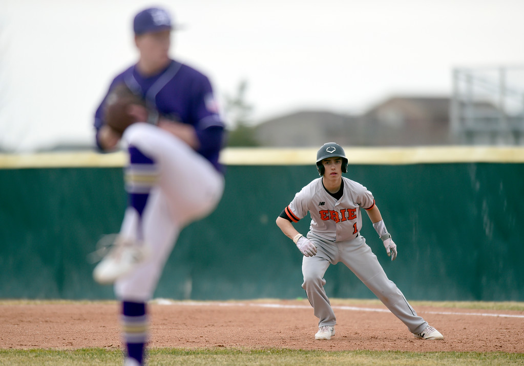 . Erie High School\'s Gavin Mendoza gets a lead at first base during a game against Holy Family on Thursday in Broomfield. More photos: BoCoPreps.com Jeremy Papasso/ Staff Photographer 03/15/2018