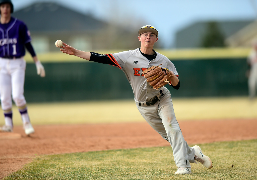 . Erie High School\'s Trevor Ball makes a throw to third base for an out during a game against Holy Family on Thursday in Broomfield. More photos: BoCoPreps.com Jeremy Papasso/ Staff Photographer 03/15/2018