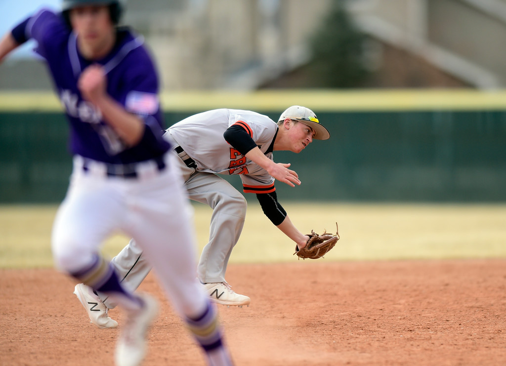 . Erie High School\'s Trevor Ball makes a stop for an out at first base during a game against Holy Family on Thursday in Broomfield. More photos: BoCoPreps.com Jeremy Papasso/ Staff Photographer 03/15/2018