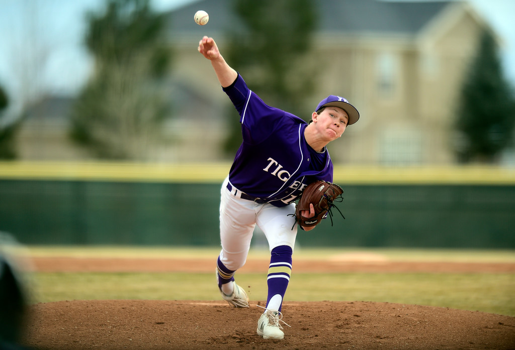. Holy Family High School\'s Wes Siefken throws a pitch during a game against Erie on Thursday in Broomfield. More photos: BoCoPreps.com Jeremy Papasso/ Staff Photographer 03/15/2018