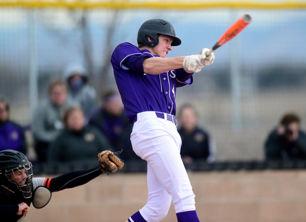 . Holy Family High School\'s Colin Kringlen gets a base hit during a game against Erie on Thursday in Broomfield. More photos: BoCoPreps.com Jeremy Papasso/ Staff Photographer 03/15/2018