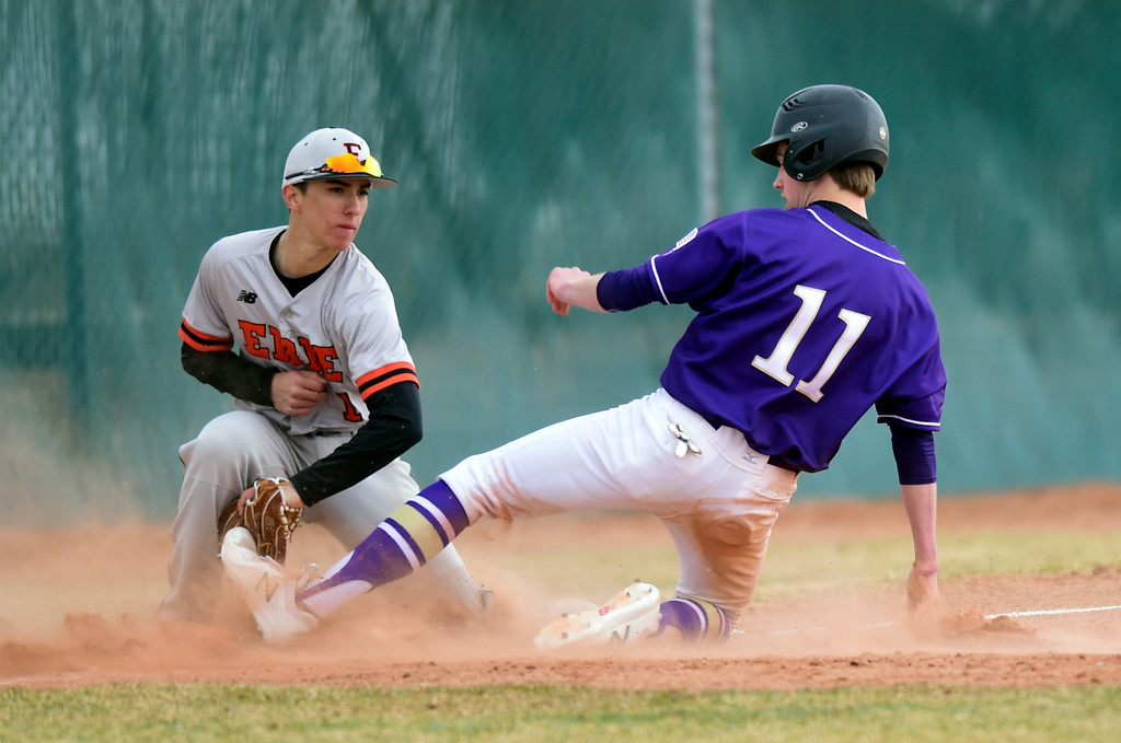 . Erie High School\'s Gavin Medoza tags out Phil Neill at third base during a game against Holy Family on Thursday in Broomfield. More photos: BoCoPreps.com Jeremy Papasso/ Staff Photographer 03/15/2018