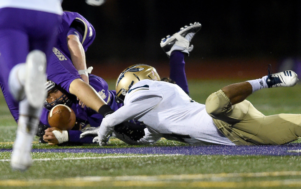 . BROOMFIELD, CO - OCTOBER 12, 2018: Holy Family High School\'s Benito Hernandez recovers a fumble during a CHSAA football game against Frederick on Friday in Broomfield. More photos: BoCoPreps.com (Photo by Jeremy Papasso/Staff Photographer)