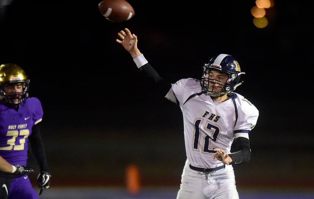 . Frederick High School quarterback Kyle Polansky passes the ball during a game against Holy Family on Friday in Broomfield. More photos go to BoCoPreps.com Jeremy Papasso/ Staff Photographer/ Oct. 6, 2017