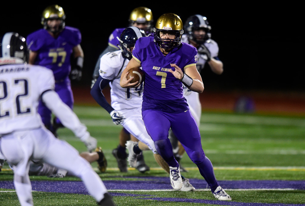 . Holy Family High School quarterback Kyle Helbig runs the ball during a game against Frederick on Friday in Broomfield. More photos go to BoCoPreps.com Jeremy Papasso/ Staff Photographer/ Oct. 6, 2017