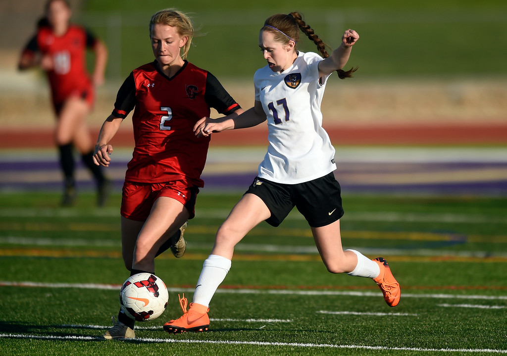 . Holy Family High School\'s Kylla Murrow fights for the ball with Julia Mulhall during a CHSAA State Semifinal soccer game against Glenwood Springs on Wednesday in Broomfield. Holy Family lost the game 3-2. More photos: BoCoPreps.com Jeremy Papasso/ Staff Photographer 05/16/2018