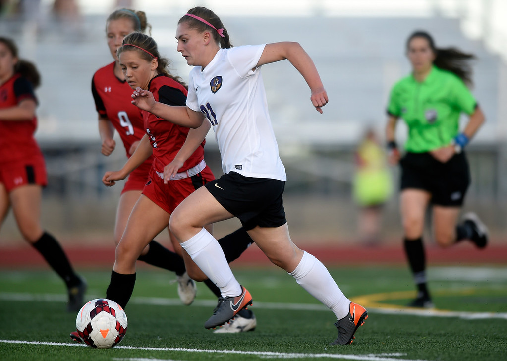 . Holy Family High School\'s Kaitlin Rentmeester moves the ball upfield during a CHSAA State Semifinal soccer game against Glenwood Springs on Wednesday in Broomfield. Holy Family lost the game 3-2. More photos: BoCoPreps.com Jeremy Papasso/ Staff Photographer 05/16/2018