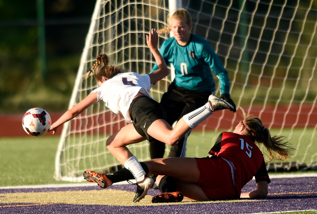 . Holy Family High School\'s Nicolette Sandoval goes down near the goal after colliding with Devan McSwain during a CHSAA State Semifinal soccer game against Glenwood Springs on Wednesday in Broomfield. Holy Family lost the game 3-2. More photos: BoCoPreps.com Jeremy Papasso/ Staff Photographer 05/16/2018