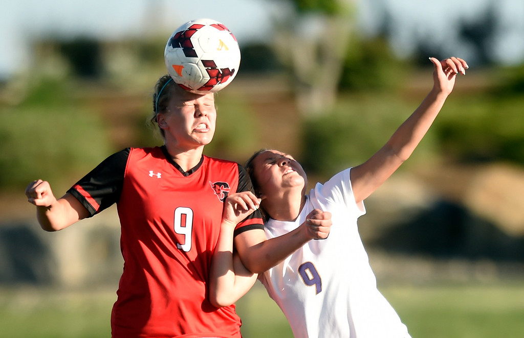 . Holy Family High School\'s Jaelen Giron tries to head the ball against Sarah Helm during a CHSAA State Semifinal soccer game against Glenwood Springs on Wednesday in Broomfield. Holy Family lost the game 3-2. More photos: BoCoPreps.com Jeremy Papasso/ Staff Photographer 05/16/2018