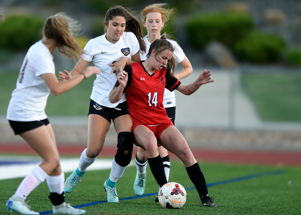 . Holy Family High School\'s Ashley Ward fights for the ball with Natalya Taylor during a CHSAA State Semifinal soccer game against Glenwood Springs on Wednesday in Broomfield. Holy Family lost the game 3-2. More photos: BoCoPreps.com Jeremy Papasso/ Staff Photographer 05/16/2018