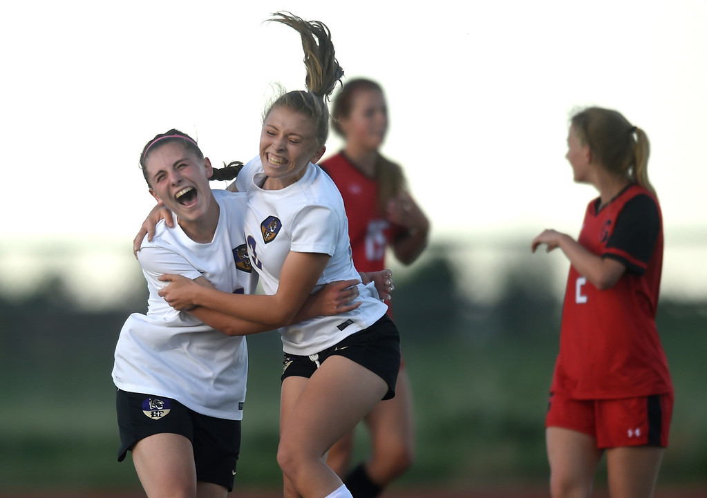 . Holy Family High School\'s Kaitlin Rentmeester, left, celebrates a goal with teammate Bailey Sloan during a CHSAA State Semifinal soccer game against Glenwood Springs on Wednesday in Broomfield. Holy Family lost the game 3-2. More photos: BoCoPreps.com Jeremy Papasso/ Staff Photographer 05/16/2018