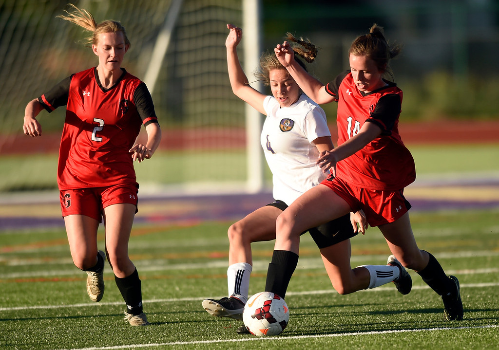 . Holy Family High School\'s Nicolette Sandoval fights for the ball with Natalya Taylor during a CHSAA State Semifinal soccer game against Glenwood Springs on Wednesday in Broomfield. Holy Family lost the game 3-2. More photos: BoCoPreps.com Jeremy Papasso/ Staff Photographer 05/16/2018