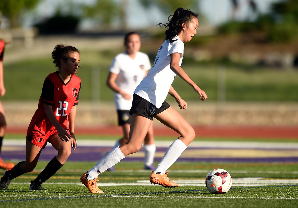 . Holy Family High School\'s Alexa Dang moves the ball upfield during a CHSAA State Semifinal soccer game against Glenwood Springs on Wednesday in Broomfield. Holy Family lost the game 3-2. More photos: BoCoPreps.com Jeremy Papasso/ Staff Photographer 05/16/2018