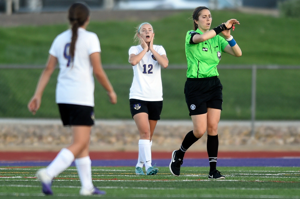 . Holy Family High School\'s Sarah Uhler, center, reacts after a Glenwood Springs goal during a CHSAA State Semifinal soccer game against Glenwood Springs on Wednesday in Broomfield. Holy Family lost the game 3-2. More photos: BoCoPreps.com Jeremy Papasso/ Staff Photographer 05/16/2018