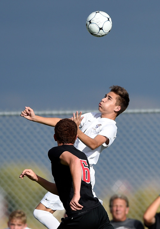 . LOVELAND, CO - OCTOBER 3, 2018: Holy Family High School\'s Jake Hulquest heads the ball during a game against Loveland on Wednesday in Loveland. More photos: BoCoPreps.com (Photo by Jeremy Papasso/Staff Photographer)