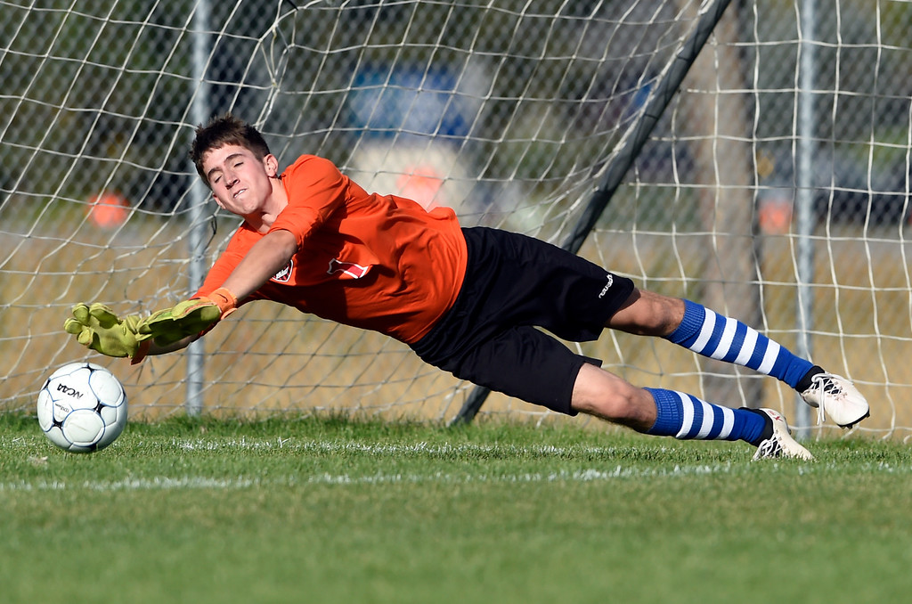 . LOVELAND, CO - OCTOBER 3, 2018: Loveland High School goalkeeper Nick Barbattini makes a diving save  during a game against Holy Family on Wednesday in Loveland. More photos: BoCoPreps.com (Photo by Jeremy Papasso/Staff Photographer)