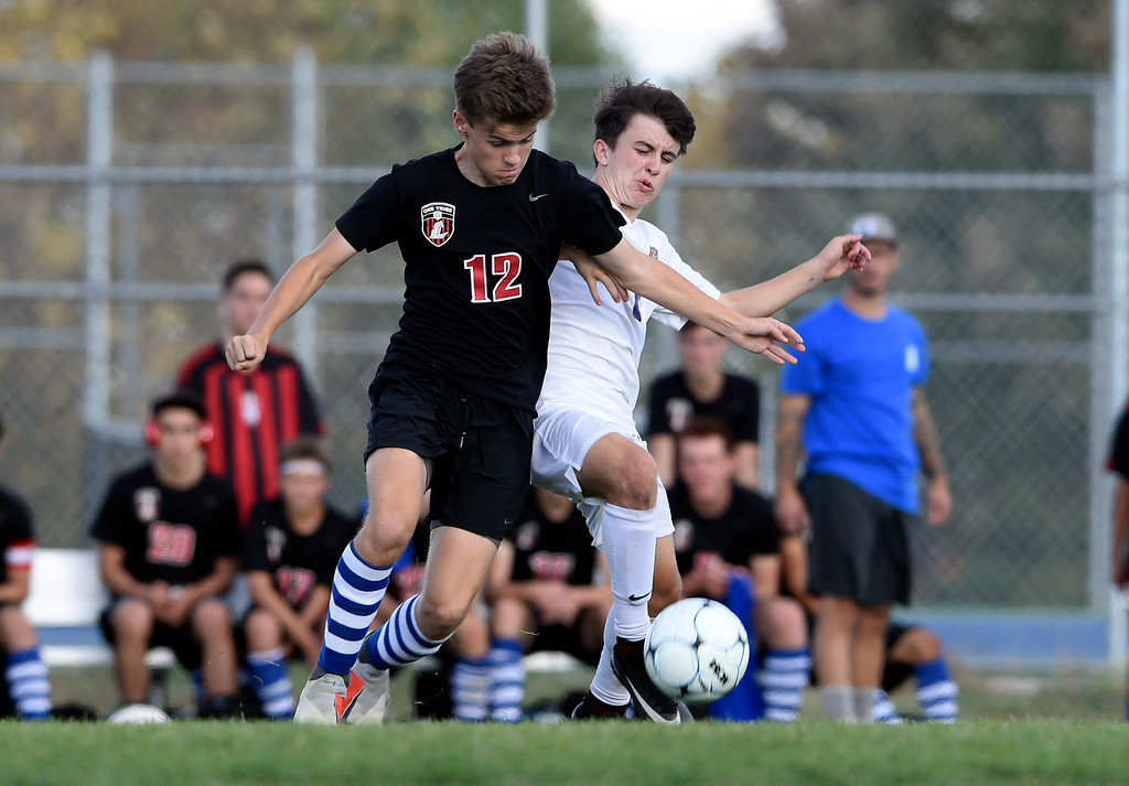 . LOVELAND, CO - OCTOBER 3, 2018: Holy Family High School\'s Dylan Macintosh, right, fights for the ball with Zachary Blundell during a game against Loveland on Wednesday in Loveland. More photos: BoCoPreps.com (Photo by Jeremy Papasso/Staff Photographer)
