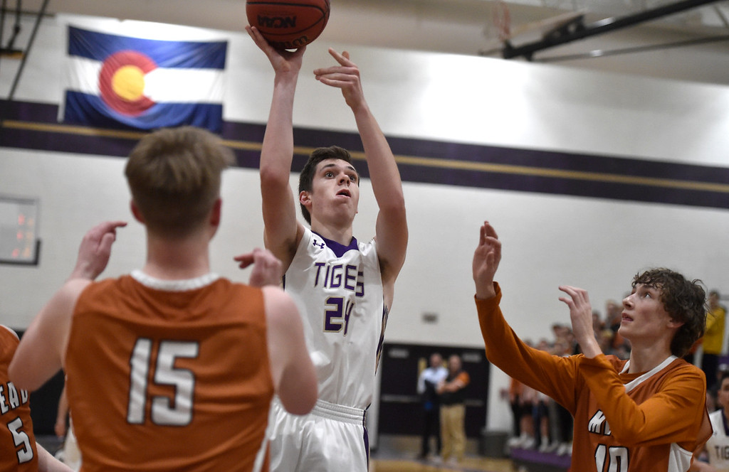 . BROOMFIELD, CO - JANUARY 23, 2019: Holy Family High School\'s Adam Jolly takes a shot during a CHSAA basketball game against Mead on Thursday in Broomfield. More photos: BoCoPreps.com (Photo by Jeremy Papasso/Staff Photographer)