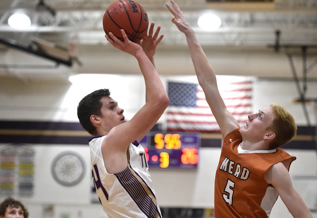 . BROOMFIELD, CO - JANUARY 23, 2019: Holy Family High School\'s Adam Jolly takes a shot over Trey Ward during a CHSAA basketball game against Mead on Thursday in Broomfield. More photos: BoCoPreps.com (Photo by Jeremy Papasso/Staff Photographer)