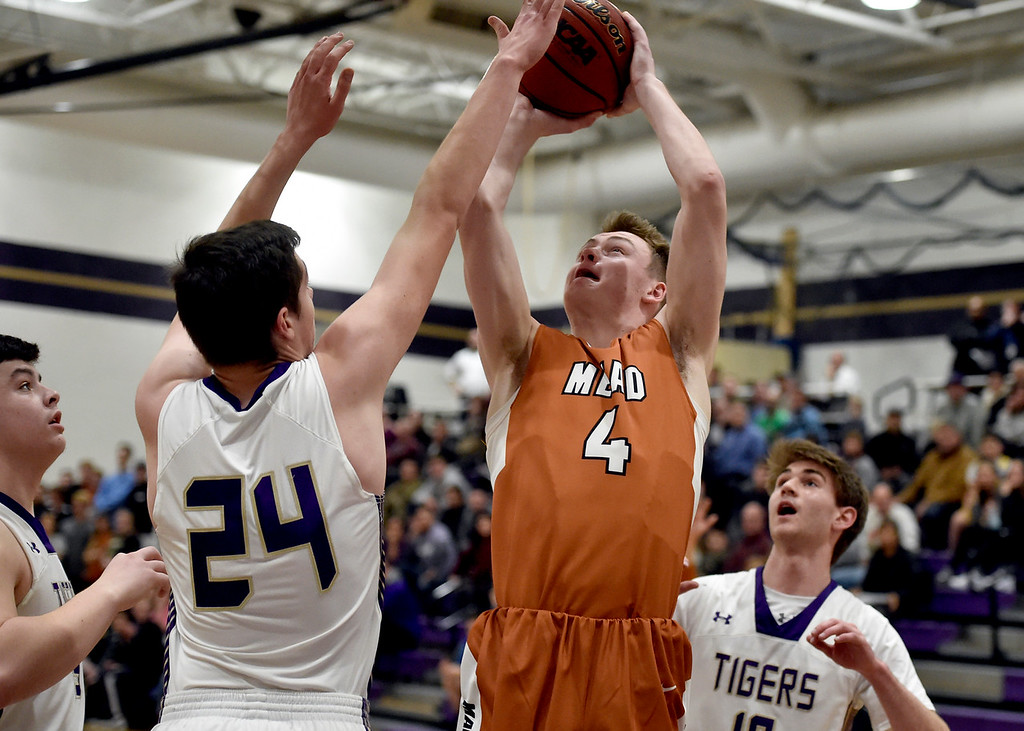 . BROOMFIELD, CO - JANUARY 23, 2019: Mead High School\'s David Wilhelm takes a shot over Adam Jolly during a CHSAA basketball game against Holy Family on Thursday in Broomfield. More photos: BoCoPreps.com (Photo by Jeremy Papasso/Staff Photographer)