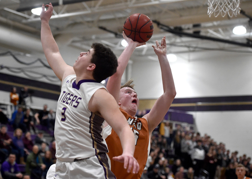 . BROOMFIELD, CO - JANUARY 23, 2019: Mead High School\'s Jax Wilke takes a shot over Kyle Helbig during a CHSAA basketball game against Holy Family on Thursday in Broomfield. More photos: BoCoPreps.com (Photo by Jeremy Papasso/Staff Photographer)