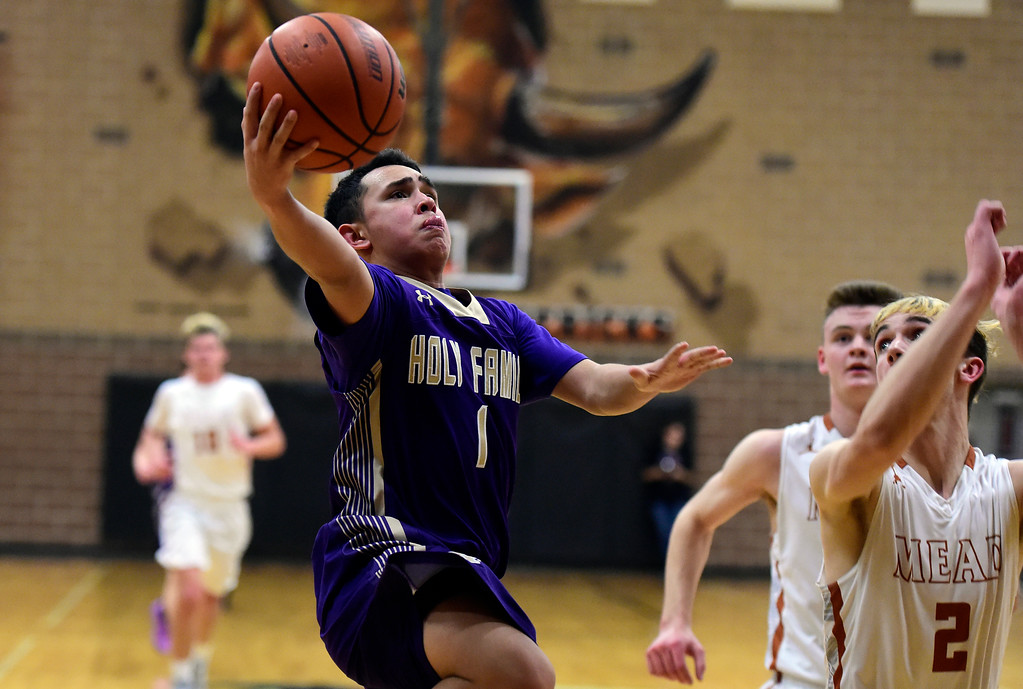 . Holy Family High School\'s Dominic Nellis drives to the hoop during a game against Mead on Tuesday in Mead. More photos: BoCoPreps.com Jeremy Papasso/ Staff Photographer 02/13/2018
