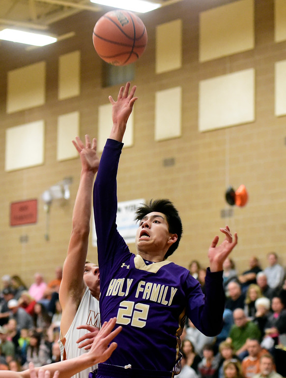 . Holy Family High School\'s Aaron Sanders takes a shot during a game against Mead on Tuesday in Mead. More photos: BoCoPreps.com Jeremy Papasso/ Staff Photographer 02/13/2018