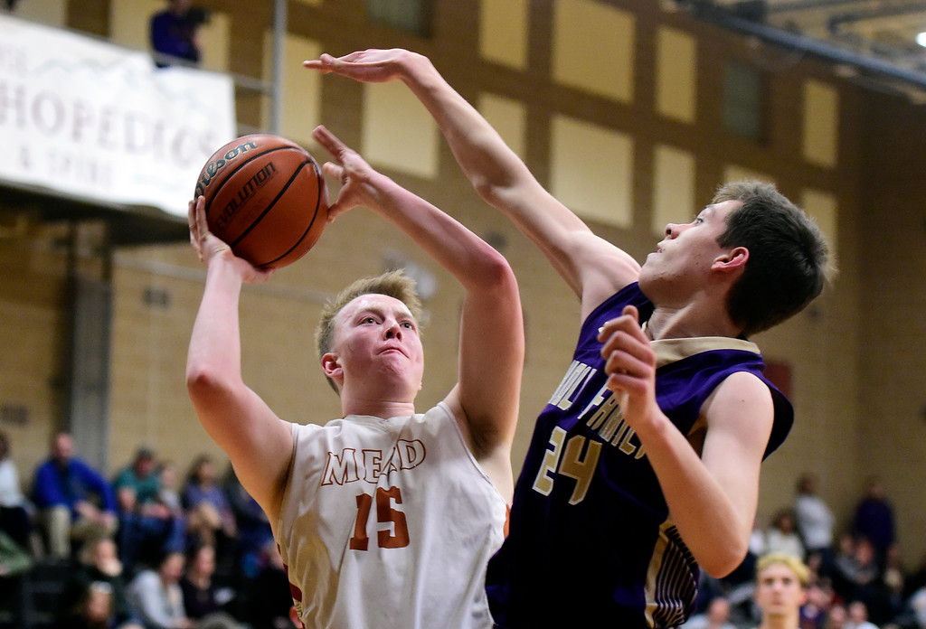 . Mead High School\'s Jax Wilke takes a shot over Adam Jolly during a game against Holy Family on Tuesday in Mead. More photos: BoCoPreps.com Jeremy Papasso/ Staff Photographer 02/13/2018