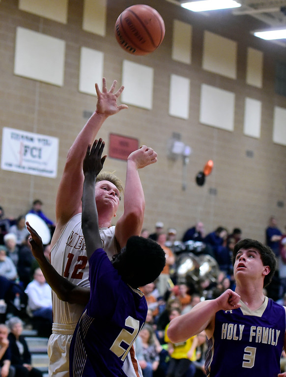 . Mead High School\'s Derek Edwards takes a shot over Wega Kinoti during a game against Holy Family on Tuesday in Mead. More photos: BoCoPreps.com Jeremy Papasso/ Staff Photographer 02/13/2018