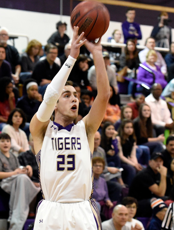 . Holy Family High School\'s Tanner Price shoots a three-pointer during a game against Mead on Tuesday in Broomfield. More photos: www.BoCoPreps.com Jeremy Papasso/ Staff Photographer/ Feb. 14, 2017