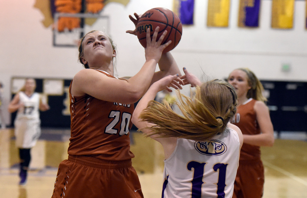 . Mead High School\'s Anna Veltien drives to the hoop past Casey Griggs during a game against Holy Family on Tuesday in Broomfield. More photos: www.BoCoPreps.com Jeremy Papasso/ Staff Photographer/ Feb. 14, 2017