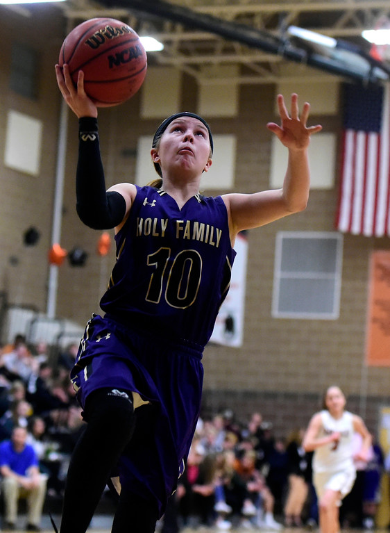 . Holy Family High School\'s Kaitlyn McKenzie goes for a layup during a game against Mead on Tuesday in Mead. More photos: BoCoPreps.com Jeremy Papasso/ Staff Photographer 02/13/2018