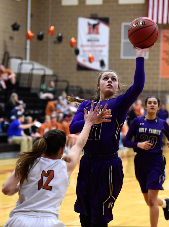 . Holy Family High School\'s Genavieve Gudino takes a shot over Renee Choksey during a game against Mead on Tuesday in Mead. More photos: BoCoPreps.com Jeremy Papasso/ Staff Photographer 02/13/2018