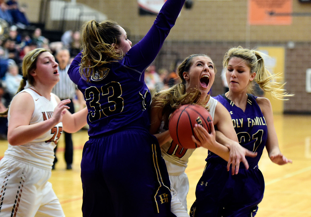 . Mead High School\'s Anna Maher tries to break through a swarm of defenders during a game against Holy Family on Tuesday in Mead. More photos: BoCoPreps.com Jeremy Papasso/ Staff Photographer 02/13/2018