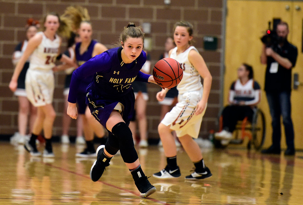 . Holy Family High School\'s Genavieve Gudino gets a fast break during a game against Mead on Tuesday in Mead. More photos: BoCoPreps.com Jeremy Papasso/ Staff Photographer 02/13/2018