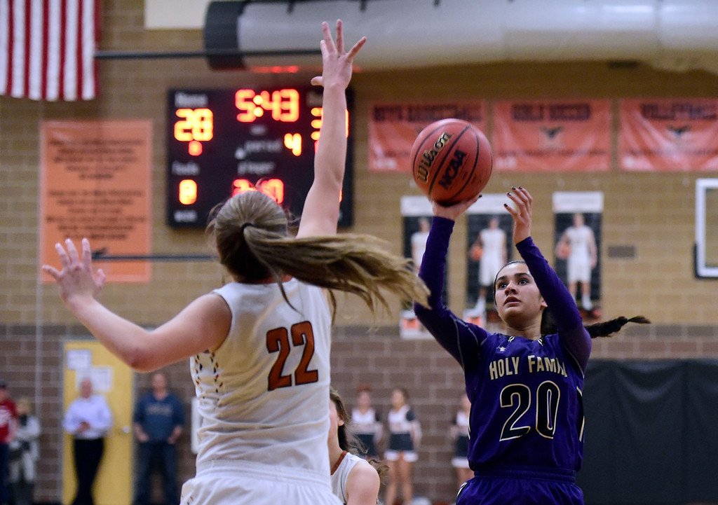 . Holy Family High School\'s Izzy Hren sinks a shot over Riley Gilbert during a game against Mead on Tuesday in Mead. More photos: BoCoPreps.com Jeremy Papasso/ Staff Photographer 02/13/2018