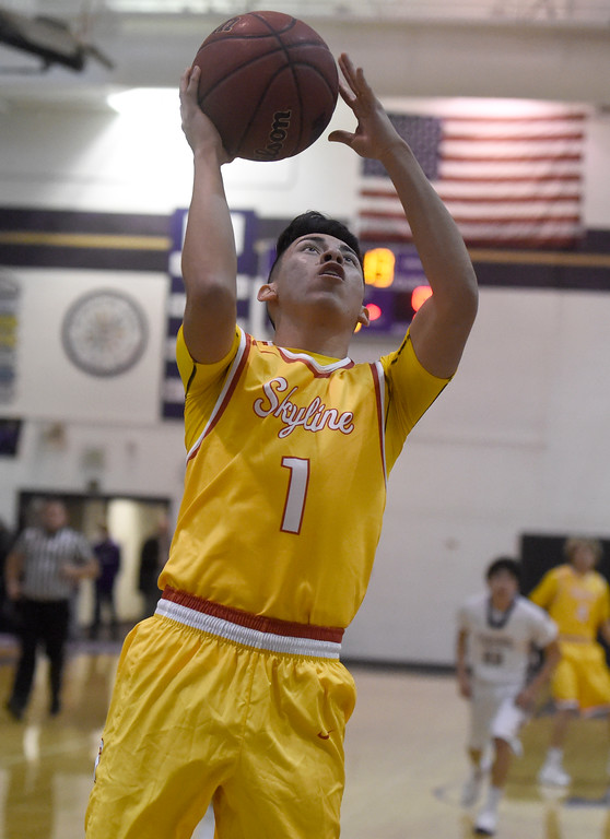 . Skyline High School\'s Ben Lopez goes for a layup during a game against Holy Family on Wednesday in Broomfield. More photos: BoCoPreps.com Jeremy Papasso/ Staff Photographer 01/03/2018