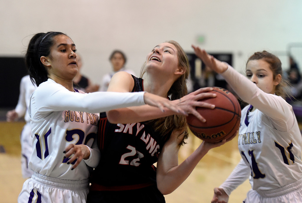 . Skyline High School\'s Ashayla Powers drives to the hoop past Izzy Hren during a game against Holy Family on Wednesday in Broomfield. More photos: BoCoPreps.com Jeremy Papasso/ Staff Photographer 01/03/2018