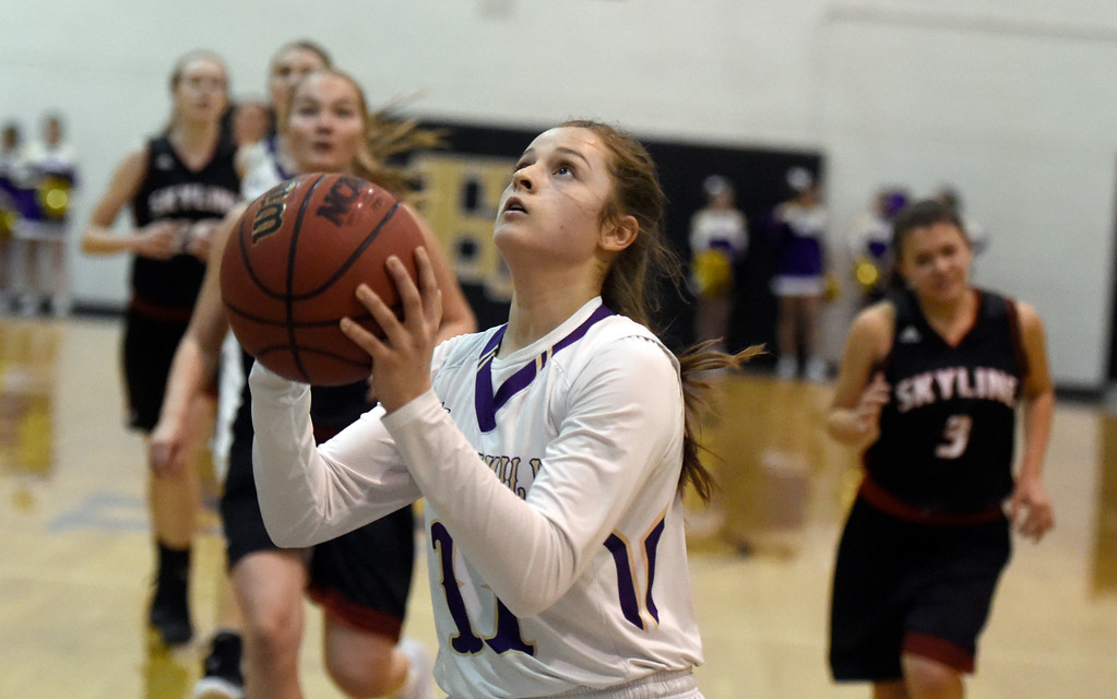 . Holy Family High School\'s Genavieve Gudino goes for a layup during a game against Skyline on Wednesday in Broomfield. More photos: BoCoPreps.com Jeremy Papasso/ Staff Photographer 01/03/2018