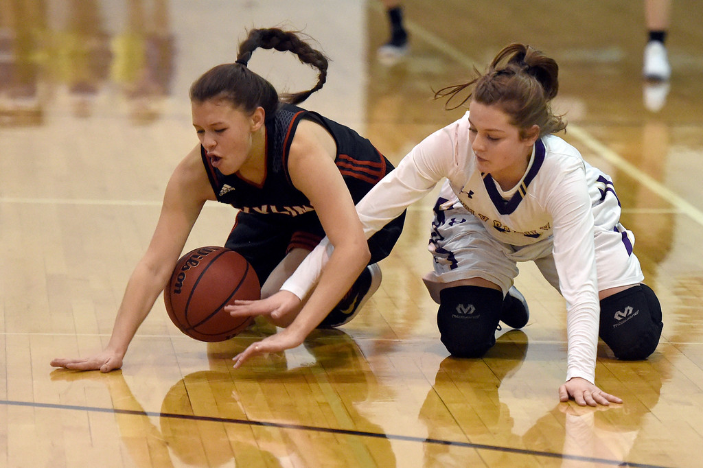 . Holy Family High School\'s Gevavieve Gudino fights for a loose ball with Gaby Bustillo during a game against Skyline on Wednesday in Broomfield. More photos: BoCoPreps.com Jeremy Papasso/ Staff Photographer 01/03/2018