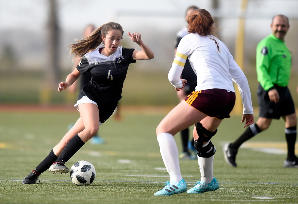 . Holy Family High School\'s Nicolette Sandoval moves the ball upfield during a game against Windsor on Monday in Windsor. More photos: BoCoPreps.com Jeremy Papasso/ Staff Photographer 04/16/2018