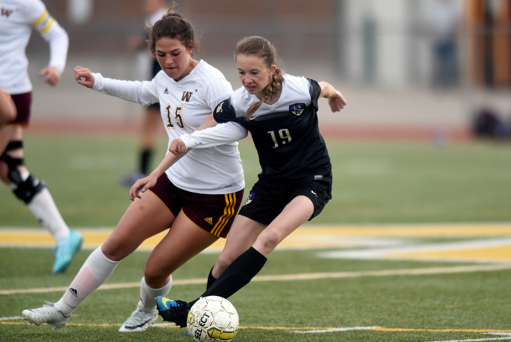 . Holy Family High School\'s Tyler Whitlock fights for the ball with Alexandra Ramirez during a game against Windsor on Monday in Windsor. More photos: BoCoPreps.com Jeremy Papasso/ Staff Photographer 04/16/2018