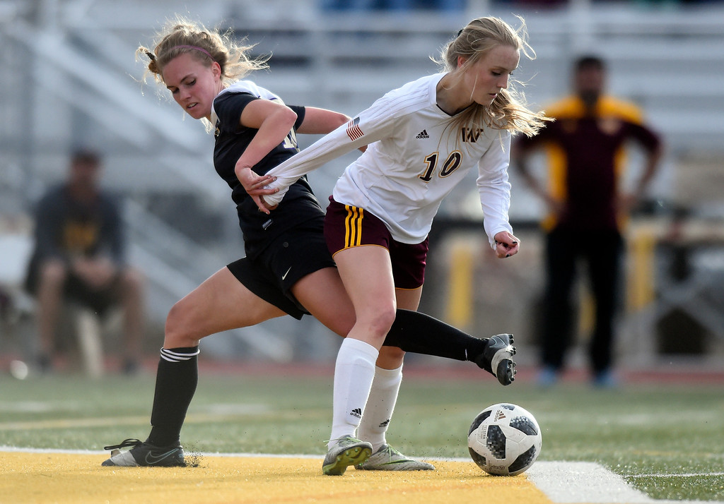. Holy Family High School\'s Kody Clements fights for the ball with Adison Watt during a game against Windsor on Monday in Windsor. More photos: BoCoPreps.com Jeremy Papasso/ Staff Photographer 04/16/2018