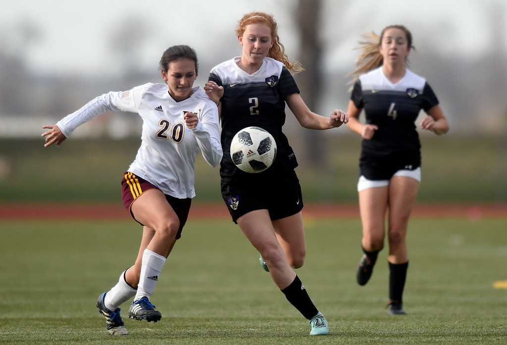 . Holy Family High School\'s Kika Napierkowski fights for the ball with Rachel Zimmerman during a game against Windsor on Monday in Windsor. More photos: BoCoPreps.com Jeremy Papasso/ Staff Photographer 04/16/2018