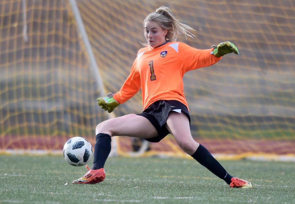 . Holy Family High School goalkeeper Alyssa Lucero makes a save during a game against Windsor on Monday in Windsor. More photos: BoCoPreps.com Jeremy Papasso/ Staff Photographer 04/16/2018