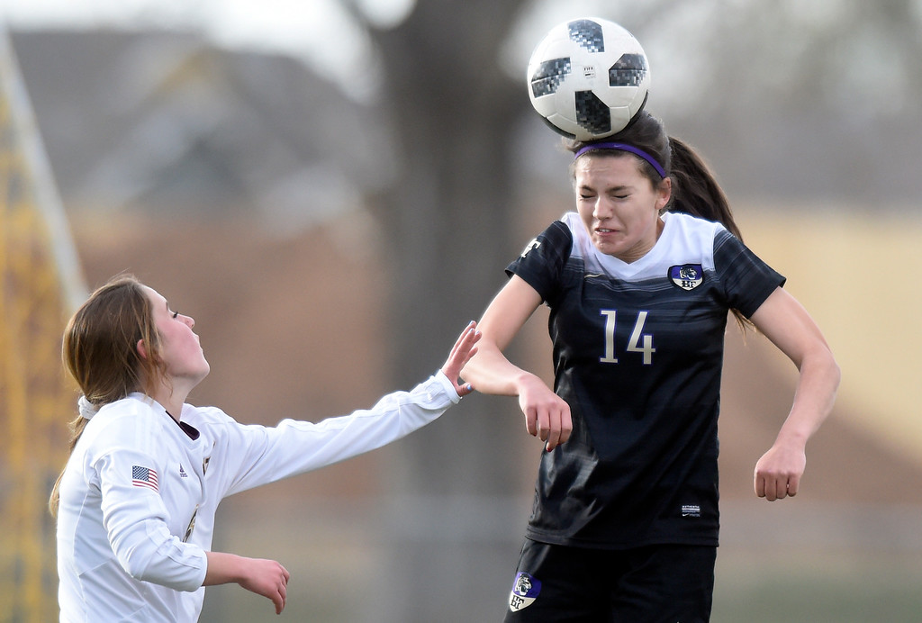 . Holy Family High School\'s Lauren Clingman heads the ball during a game against Windsor on Monday in Windsor. More photos: BoCoPreps.com Jeremy Papasso/ Staff Photographer 04/16/2018