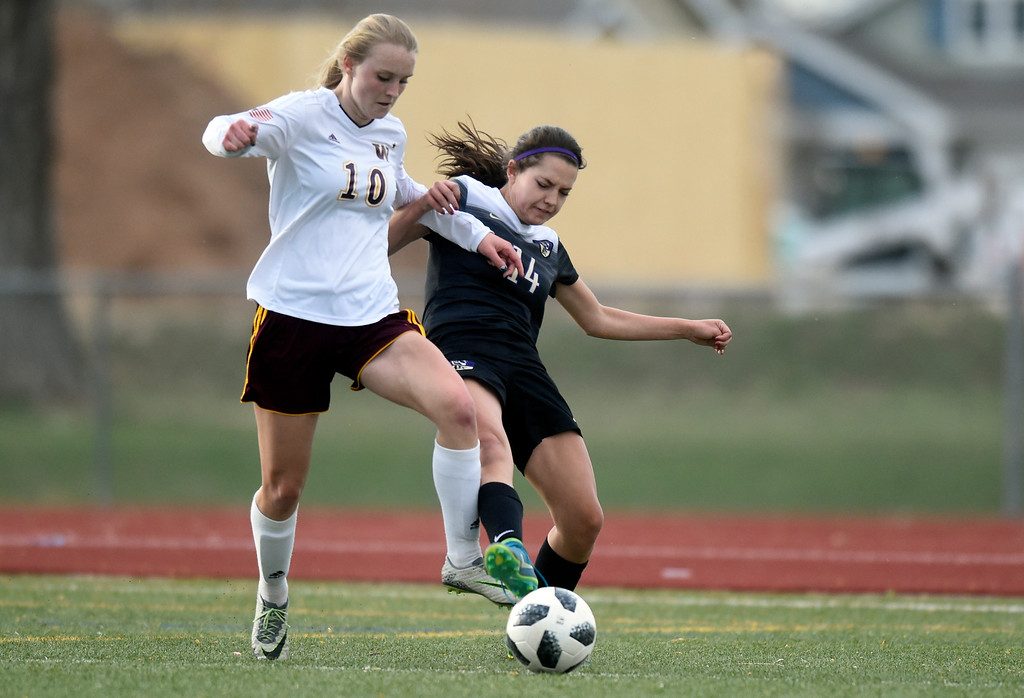 . Holy Family High School\'s Lauren Clingman fights for the ball with Adison Watt during a game against Windsor on Monday in Windsor. More photos: BoCoPreps.com Jeremy Papasso/ Staff Photographer 04/16/2018