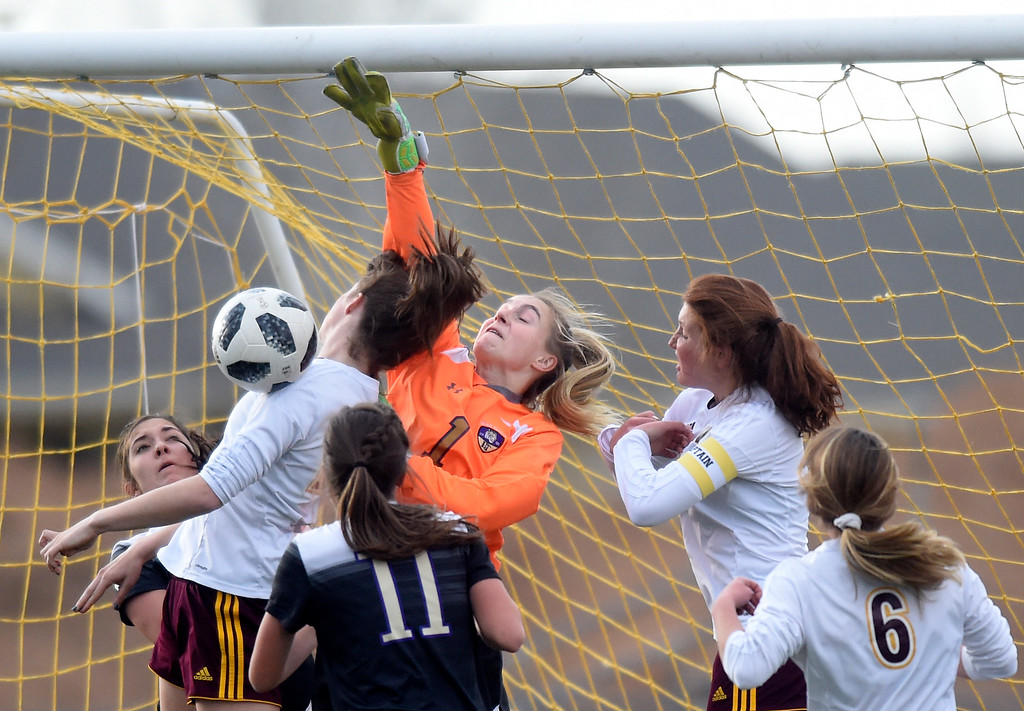 . Holy Family High School goalkeeper Alyssa Lucero jumps to block a goal attempt during a game against Windsor on Monday in Windsor. More photos: BoCoPreps.com Jeremy Papasso/ Staff Photographer 04/16/2018